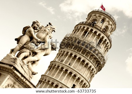 Leaning tower and statue angel in Pisa, Tuscany, Italy - stock photo