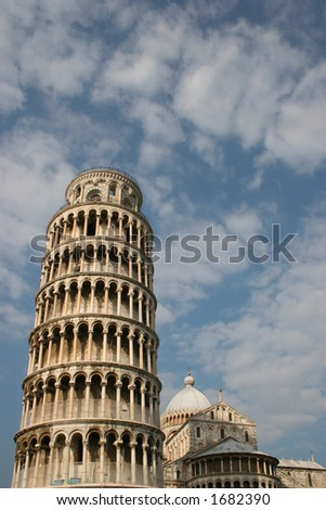 Leaning Tower of Pisa with blue sky and clouds. - stock photo