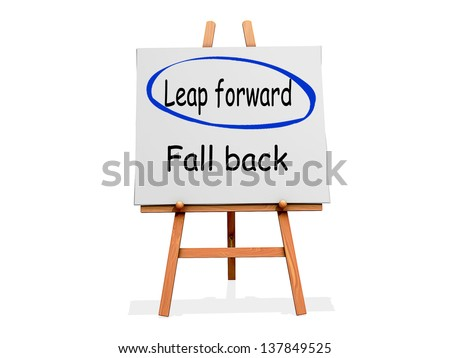 Leap Forward Not Fall Back on a sign.