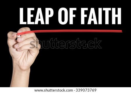 Leap of Faith word writing by men hand holding highlighter pen with line on dark background - stock photo
