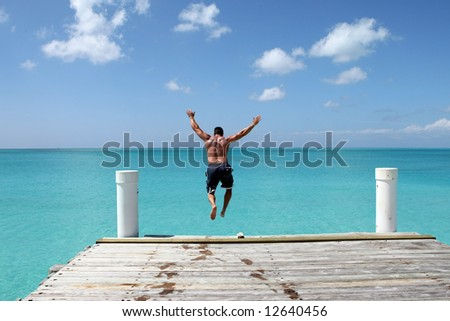 Leaping from a pier - stock photo