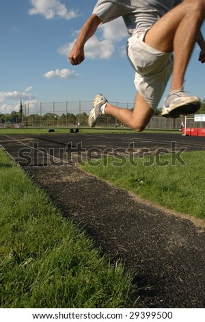 Leaping track and field runner