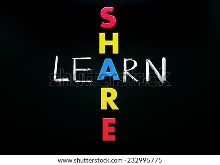 Learn and share, words on blackboard with colorful alphabets. - stock photo