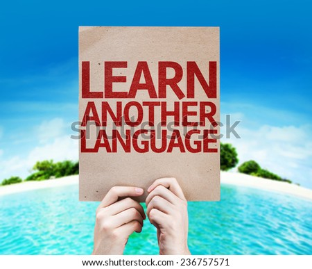 Learn Another Language card with a beach on background - stock photo
