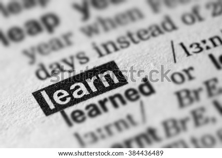 Learn Definition Word Text in Dictionary Page - stock photo