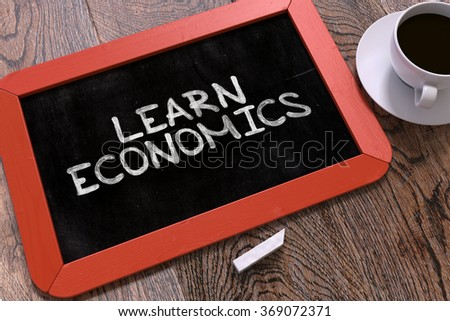 Learn Economics Handwritten on Red Chalkboard. Business Concept. Composition with Chalkboard and Cup of Coffee. Top View Image. 3d. - stock photo