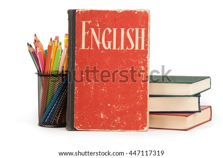 Learn English concept. School supplies and books over a white background - stock photo