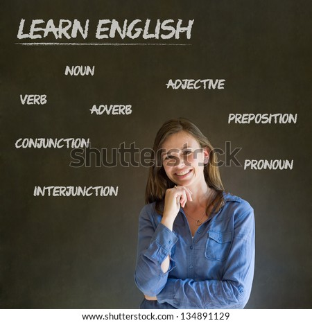 Learn English confident beautiful woman teacher chalk blackboard background - stock photo