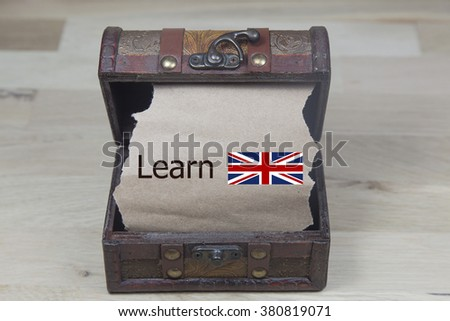 learn english is written on the Brown torn paper in the treusary box - stock photo