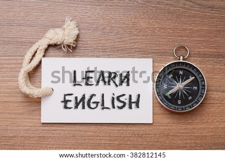 Learn English - Words handwriting on label with compass - stock photo