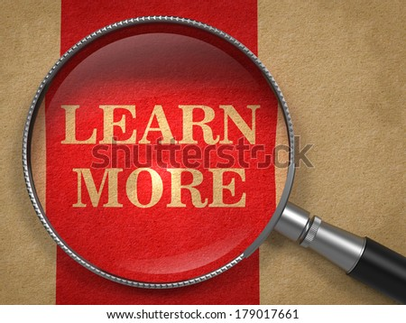 Learn More concept. Magnifying Glass on Old Paper with Red Vertical Line Background. - stock photo