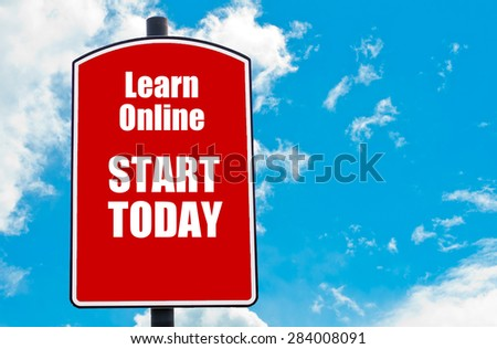 Learn Online Start Today motivational quote written on red road sign isolated over clear blue sky background. Concept  image with available copy space - stock photo