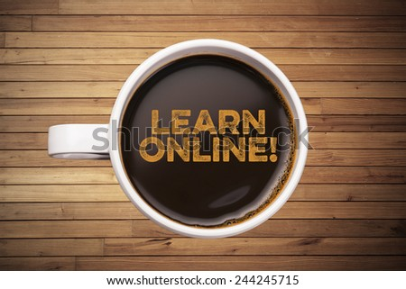 learn online! wood background with coffee mug - stock photo