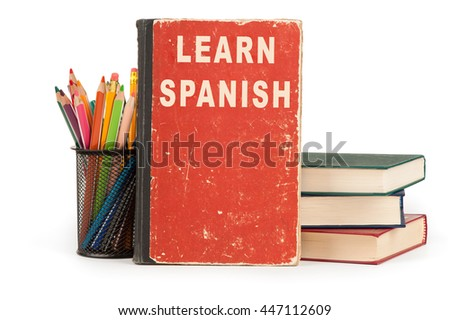 learn spanish language. school supplies isolated on white background - stock photo