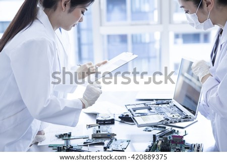 Learn the machine works, take advantage of in the future to understand, women love to study. - stock photo