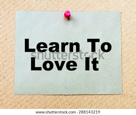 Learn To Love It written on paper note pinned with red thumbtack on wooden board. Business conceptual Image - stock photo