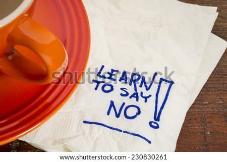 learn to say no advice - handwriting on a napkin with cup of coffee - stock photo