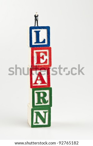 Learn word and toy business man - stock photo