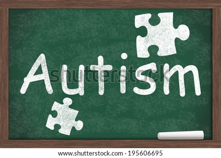 Learning about Autism ,Autism written on a chalkboard with chalk - stock photo