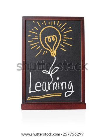 Learning alphabet with bulb idea on chalkboard isolated on white  - stock photo