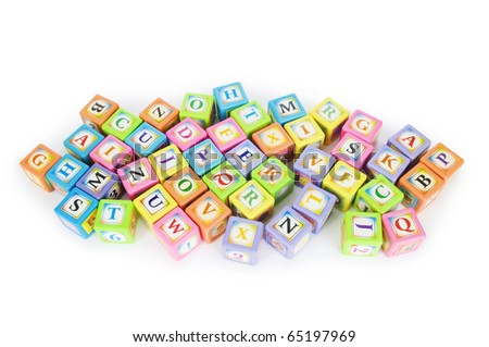 Learning and education concept - pile of alphabet blocks - stock photo