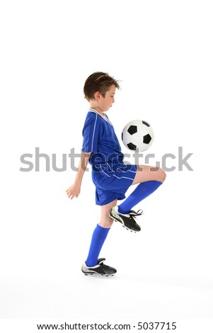 Learning ball control by practicing various soccer skills. Slight motion to foot and ball - stock photo