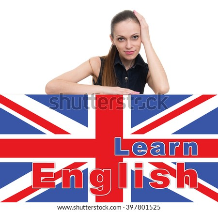 learning english concept. Attractive woman looking over top of banner - stock photo