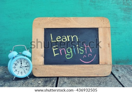 Learning English on blackboard. - stock photo