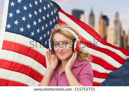 Learning language � American English (blond woman with headphones, city background) - stock photo