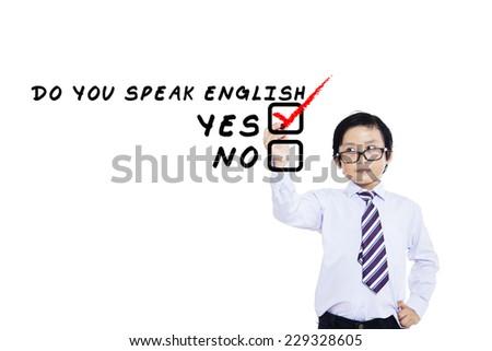 Learning language concept. Elementary school student write Do You Speak English? - stock photo
