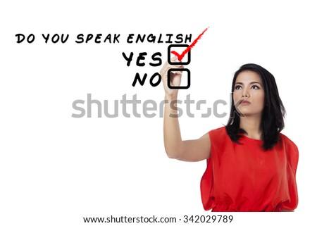 Learning language concept. Female student write Do You Speak English? - stock photo