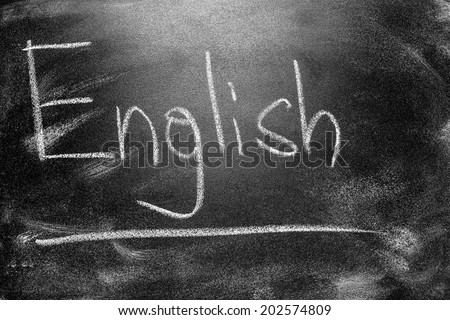 Learning language - English. Blackboard education concept.  Handwritten message on a school chalkboard writing English