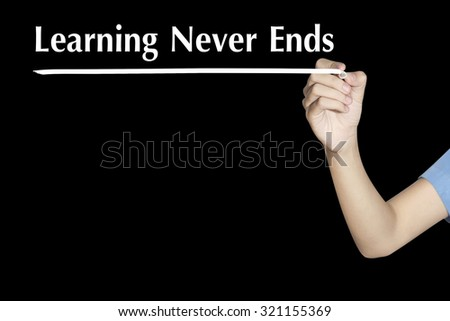 Learning Never Ends Woman writing word with black screen - stock photo