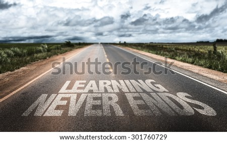 Learning Never Ends written on rural road - stock photo