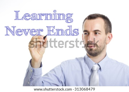 Learning Never Ends  - Young businessman writing blue text on transparent surface - stock photo