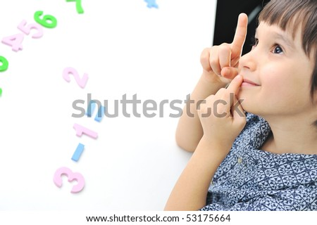 Learning process, cute kid ready for school's activities - stock photo