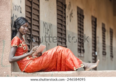 Learning Symbol: Education for Africa Young Woman Working On Tablet - stock photo