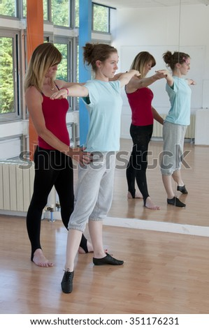 Learning to dance teenager and teacher in a dance studio