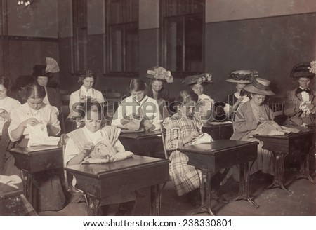 Learning to embroider in the free evening school, Boston Massachusetts, photograph by Lewis Wickes Hine, October, 1909.