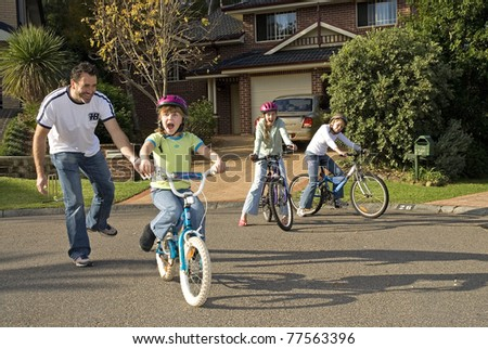 Learning to ride her bike - stock photo
