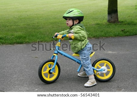 Learning to ride on a first bike - stock photo