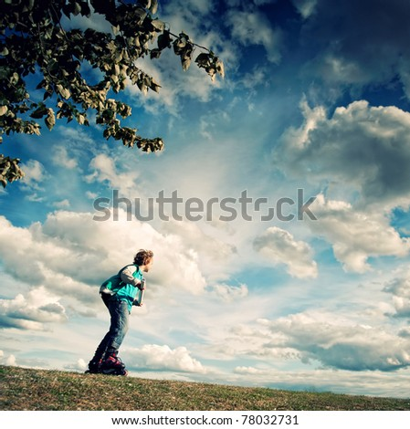 Learning to ride on rollerblades - stock photo