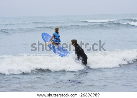 Learning to Surf - stock photo