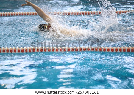 Learning to swim in the pool - stock photo