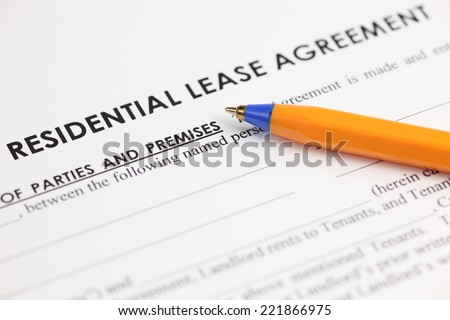 Lease agreement and ballpoint pen. Close-up.