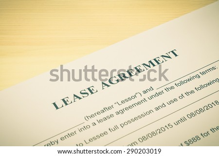 Lease Agreement Contract Document on Wood Table in Vintage Style. Legal document for business event