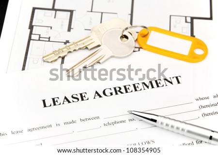 Lease agreement document with keys and pen - stock photo