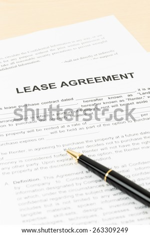Lease agreement with pen; document is mock-up - stock photo