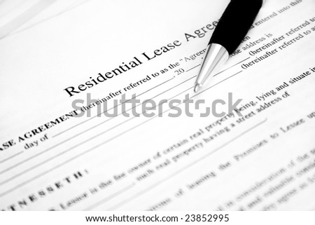 Lease agreement with pen. Used selective focus and shallow Depth of field. - stock photo