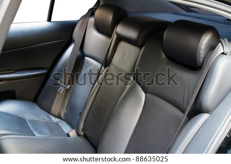 Leather back car seats with active headrest - stock photo